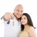 couple holding keys by David Castillo Dominici
