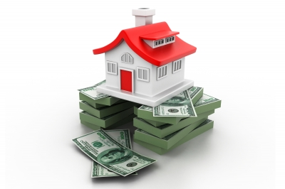 house on stack of money by hywards